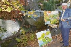Artist Paints The Beautiful Bow Bridge, In Autumn